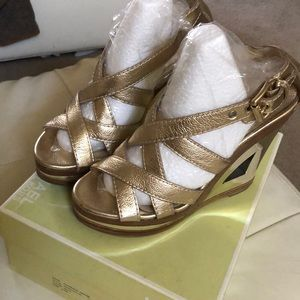 Micheal Kors gold wedges